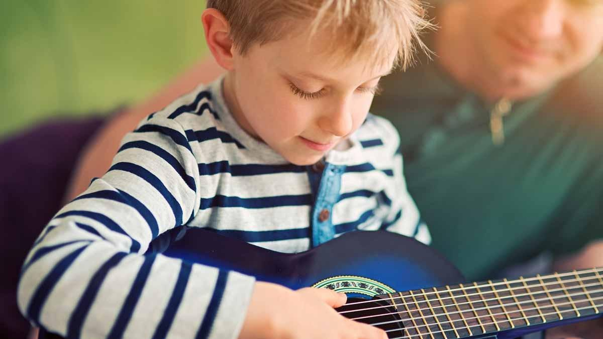 A child playing a guitar